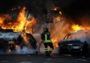 Firemen extinguish a car set on fire at