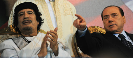 Libyan leader Moamer Kadhafi (L) applaud