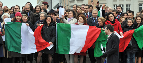 Italians hold their flag on 17 March 201