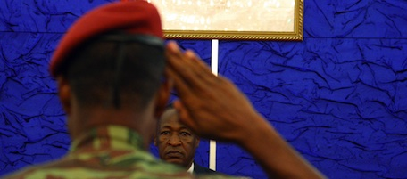 A soldier salutes Burkina Faso President