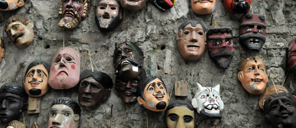 Wooden masks are offered to tourists at