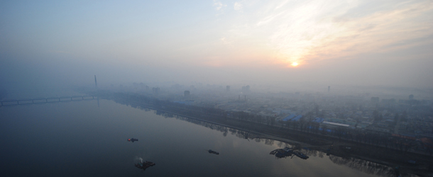 The sun rises above the Pyongyang city s
