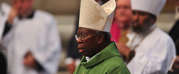 Nigerian Cardinal Francis Arinze (C) att