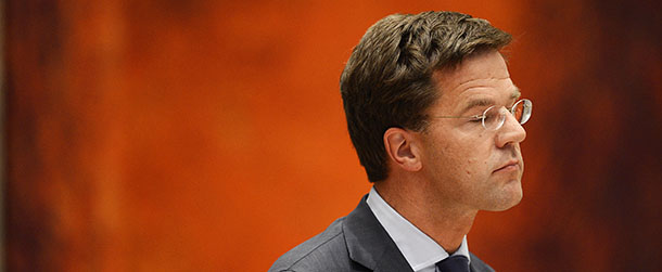 Outgoing Prime Minister Mark Rutte react