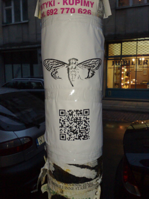 (http://en.m.wikipedia.org/wiki/File:Cicada_3301_Poster_Warsaw.jpg)
