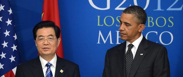 US President Barack Obama (R) looks at C