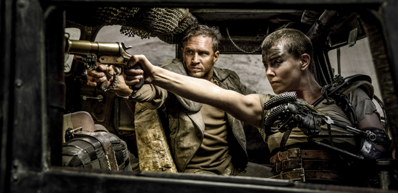 "This photo provided by Warner Bros. Pictures shows Tom Hardy, center, as Max Rockatansky and Charlize Theron, right, as Imperator Furiosa in Warner Bros. Pictures' and Village Roadshow Pictures' action adventure film, ""Mad Max:Fury Road,"" a Warner Bros. Pictures release. (Jasin Boland/Warner Bros. Pictures via AP)"