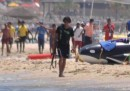 La foto dell'attentatore di Susa in spiaggia con un kalashnikov
