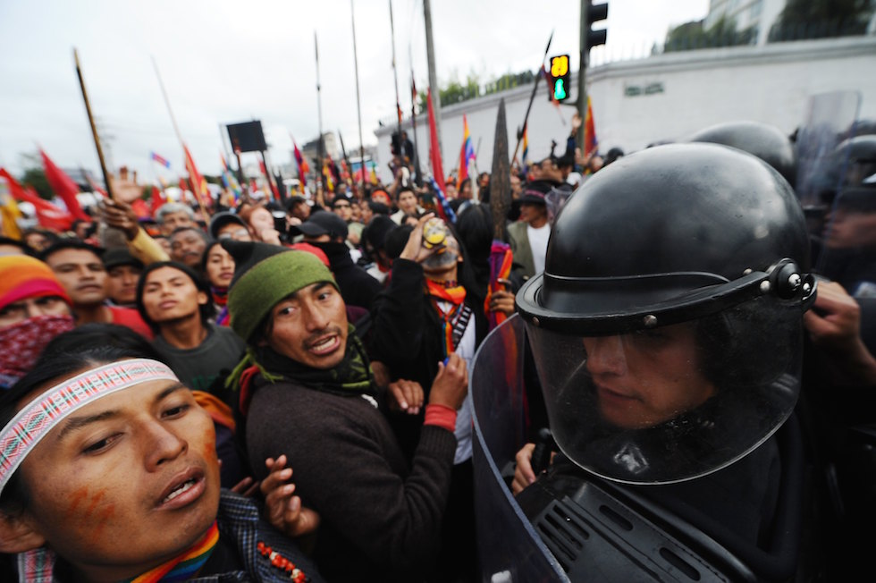 Demonstrators struggle with riot police