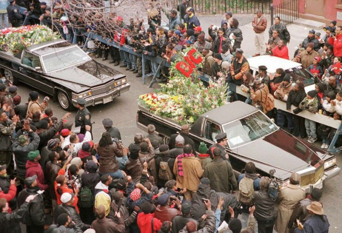 Funeral cars filled with floral tributes to rapper