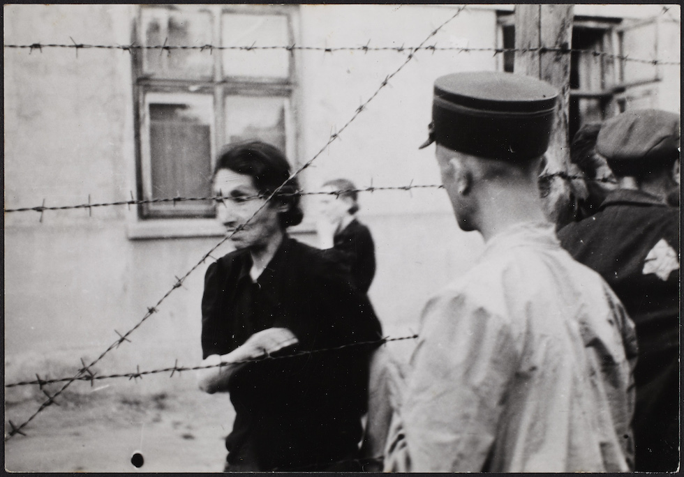 03. Ghetto police with woman behind barbed wire_Henryk Ross