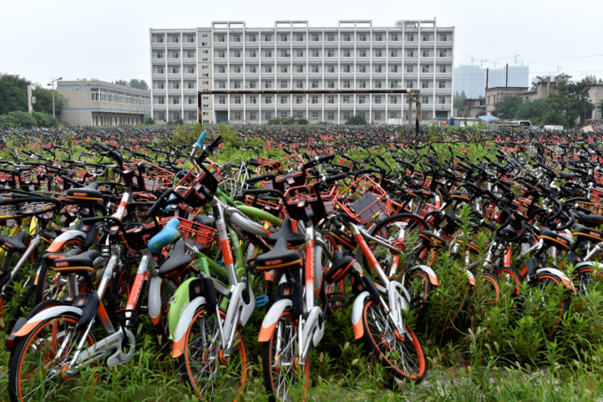 Mountain of bicycles of bike-sharing occupies playground in E China's school