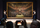 """Il dipinto di Banksy """"Devolved Parliament"""" è stato venduto all'asta per 9,8 milioni di sterline"""